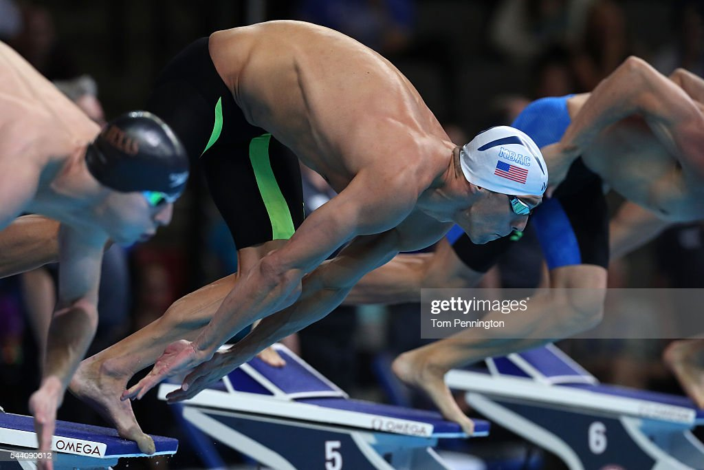 <a gi-track='captionPersonalityLinkClicked' href=/galleries/search?phrase=Michael+Phelps&family=editorial&specificpeople=162698 ng-click='$event.stopPropagation()'>Michael Phelps</a> of the United States dives in to compete in a heat for the Men's 100 Meter Butterfly during Day Six of the 2016 U.S. Olympic Team Swimming Trials at CenturyLink Center on July 1, 2016 in Omaha, Nebraska.