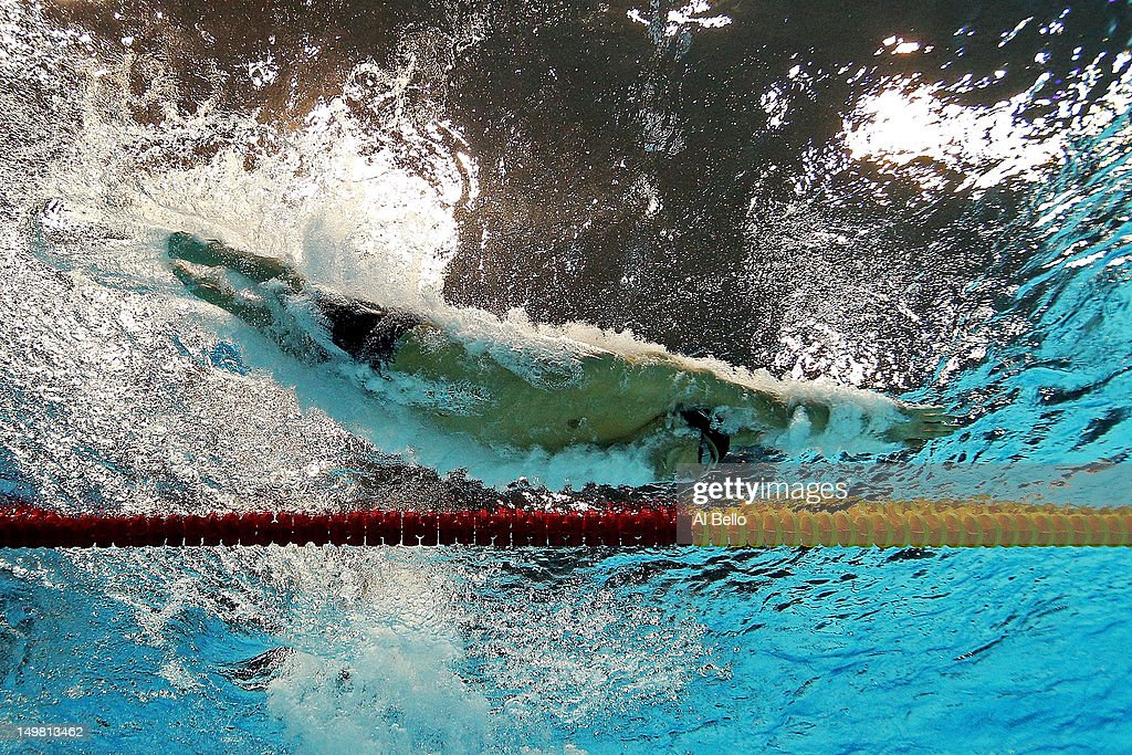 <a gi-track='captionPersonalityLinkClicked' href=/galleries/search?phrase=Michael+Phelps&family=editorial&specificpeople=162698 ng-click='$event.stopPropagation()'>Michael Phelps</a> of the United States dives into the pool in the Men's 100m medley Final on Day 8 of the London 2012 Olympic Games at the Aquatics Centre on August 4, 2012 in London, England.