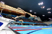 Michael Phelps of the United States dives off the starting blocks in the Men's 100m Butterfly heat 6 on Day 6 of the London 2012 Olympic Games at the...