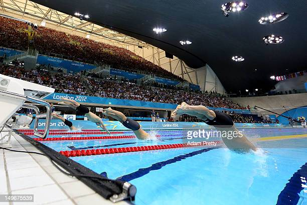 michael phelps of the united states dives off the starting blocks in the mens 100m butterfly