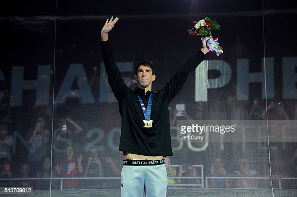 Michael Phelps of the United States participates in the medal ceremony for the Men's 200 Meter Butterfly during Day Four of the 2016 US Olympic Team...