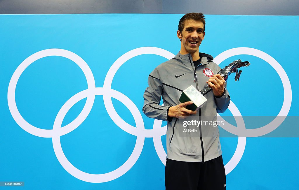 <a gi-track='captionPersonalityLinkClicked' href=/galleries/search?phrase=Michael+Phelps&family=editorial&specificpeople=162698 ng-click='$event.stopPropagation()'>Michael Phelps</a> of the United States poses on the podium with a special award presented by FINA for his career achievements on Day 8 of the London 2012 Olympic Games at the Aquatics Centre on August 4, 2012 in London, England.