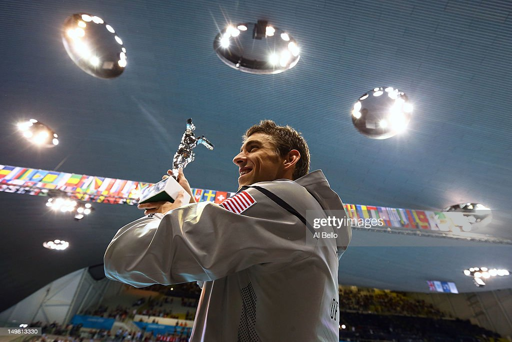 <a gi-track='captionPersonalityLinkClicked' href=/galleries/search?phrase=Michael+Phelps&family=editorial&specificpeople=162698 ng-click='$event.stopPropagation()'>Michael Phelps</a> of the United States poses with a special award presented by FINA for his career achievements on Day 8 of the London 2012 Olympic Games at the Aquatics Centre on August 4, 2012 in London, England.