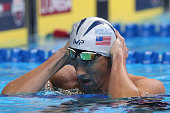 Michael Phelps of the United States reacts after finishing first in the final heat for the Men's 200 Meter Individual Medley during Day Six of the...