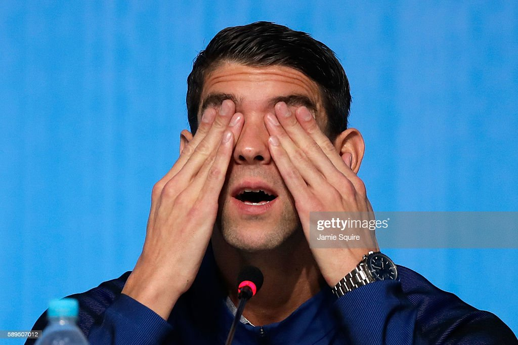Michael Phelps of the United States wipes his eyes during a press conference at the Main Press Centre on August 14 2016 in Rio de Janeiro Brazil