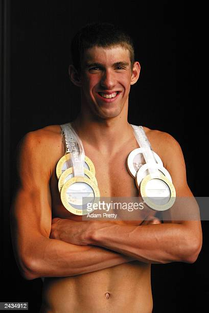 Michael Phelps of the USA smiles as he wears his six medals won during the 10th Fina World Swimming Championships 2003 at Palau Sant Jordi July 27...