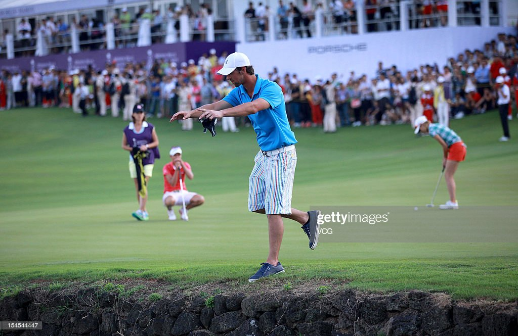 <a gi-track='captionPersonalityLinkClicked' href=/galleries/search?phrase=Michael+Phelps&family=editorial&specificpeople=162698 ng-click='$event.stopPropagation()'>Michael Phelps</a> of USA poses after hitting his shot into the water during day four of the Mission Hills Star Trophy at the Mission Hills Golf Club on October 21, 2012 in Haikou, China.
