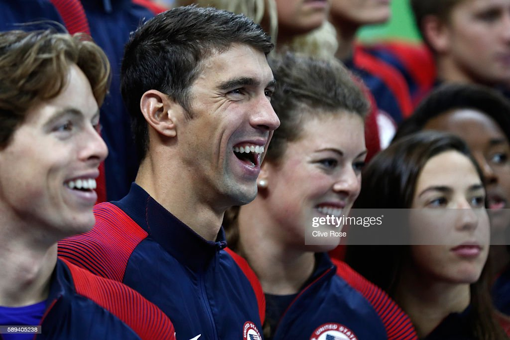 Michael Phelps poses for a photo with members of the United States swim team on Day 8 of the Rio 2016 Olympic Games at the Olympic Aquatics Stadium...