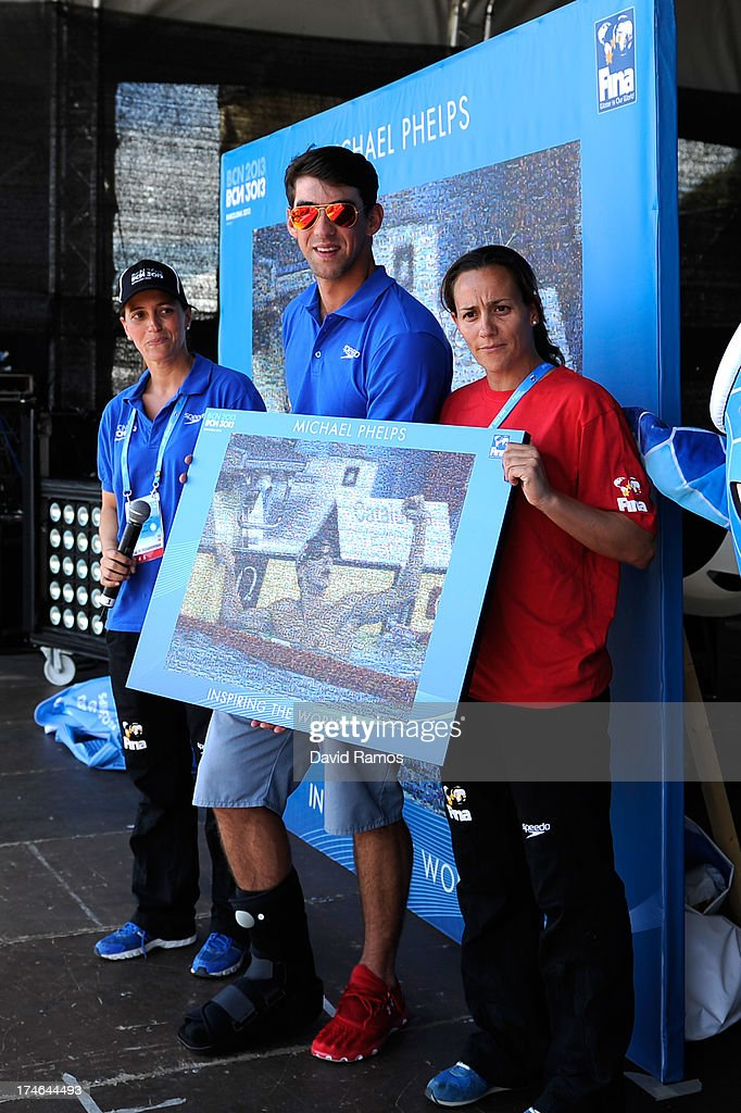 <a gi-track='captionPersonalityLinkClicked' href=/galleries/search?phrase=Michael+Phelps&family=editorial&specificpeople=162698 ng-click='$event.stopPropagation()'>Michael Phelps</a> poses with a mosaic featuring one of his victories on the last Barcelona 2003 Swimming Championships during the Barcelona 2013 World Swimming Championships on July 28, 2013 in Barcelona, Spain.