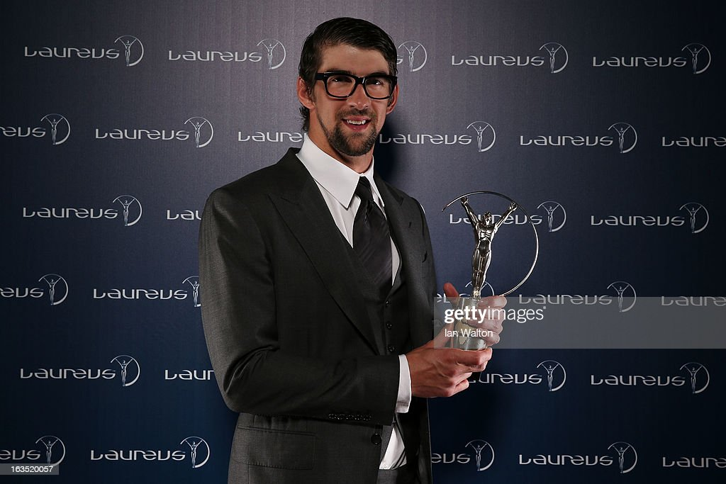 Michael Phelps poses with the award for Laureus Academy Exceptional Achievement Award in the winners studio during the 2013 Laureus World Sports Awards at Theatro Municipal do Rio de Janeiro on March 11, 2013 in Rio de Janeiro, Brazil.