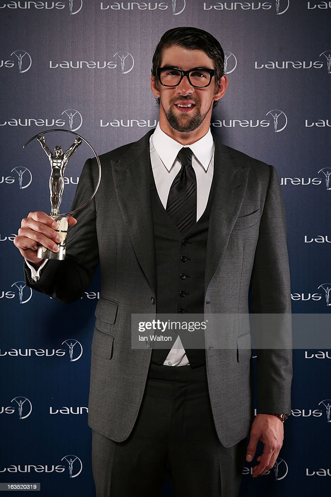 <a gi-track='captionPersonalityLinkClicked' href=/galleries/search?phrase=Michael+Phelps&family=editorial&specificpeople=162698 ng-click='$event.stopPropagation()'>Michael Phelps</a> poses with the award for Laureus Academy Exceptional Achievement Award in the winners studio during the 2013 Laureus World Sports Awards at Theatro Municipal do Rio de Janeiro on March 11, 2013 in Rio de Janeiro, Brazil.