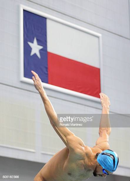 Michael Phelps prepares to swim in the Men's 100 meter butterfly final during the Arena Pro Swim Series at Austin on January 15 2016 in Austin Texas