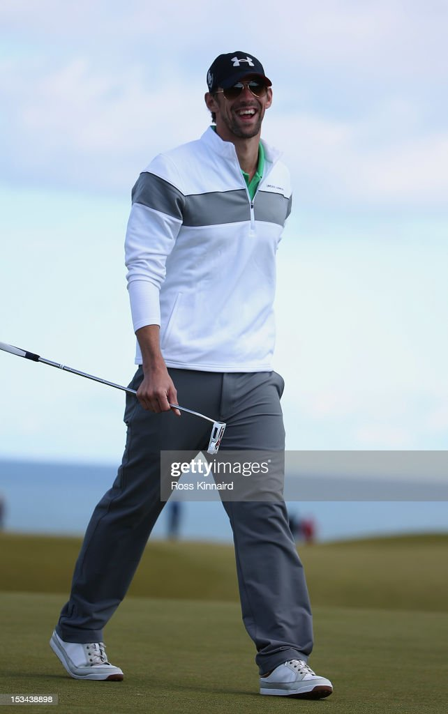 <a gi-track='captionPersonalityLinkClicked' href=/galleries/search?phrase=Michael+Phelps&family=editorial&specificpeople=162698 ng-click='$event.stopPropagation()'>Michael Phelps</a> reacts after putting on the nineth green during the second round of The Alfred Dunhill Links Championship at Kingsbarns Golf Links on October 5, 2012 in Kingsbarns, Scotland.