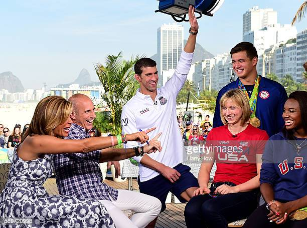 Michael Phelps reacts to a question from Matt Lauer as Hoda Kotb Katie Ledecky Nathan Adrian and Simone Manuel laugh on the Today show set on...