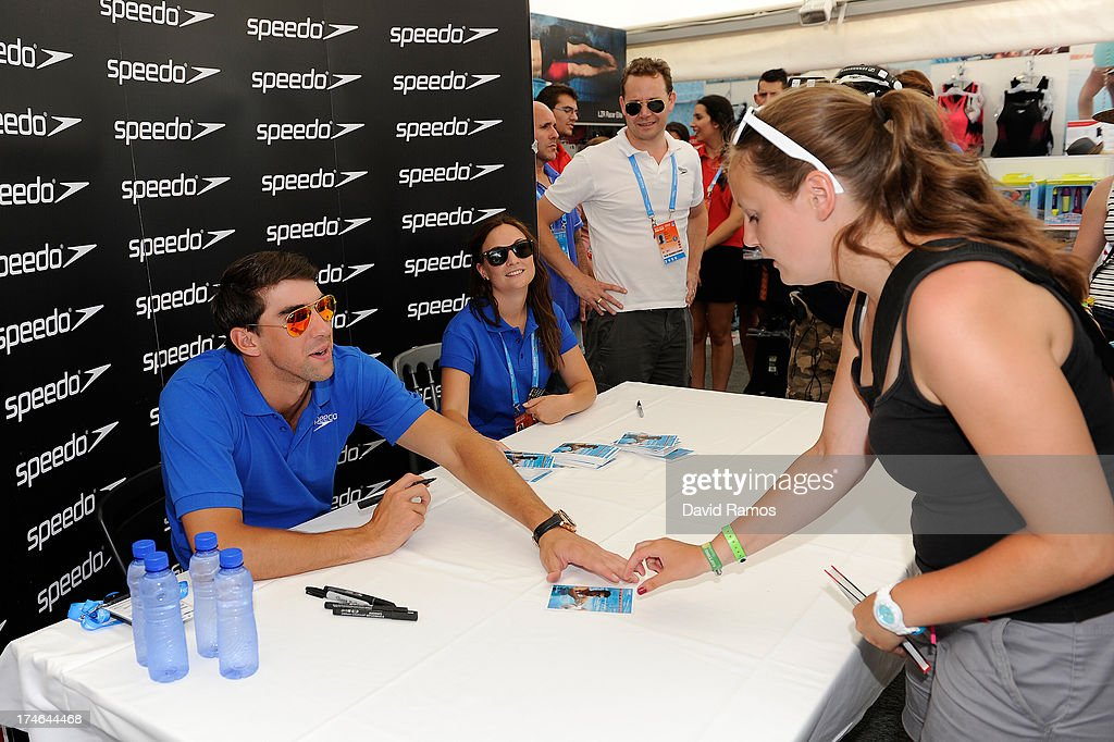 Michael Phelps signs autographs during his visit to the Speedo Store during the Barcelona 2013 World Swimming Championships on July 28, 2013 in Barcelona, Spain.