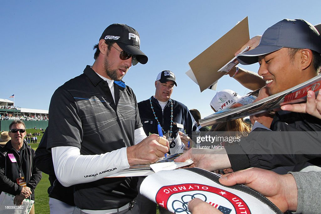 <a gi-track='captionPersonalityLinkClicked' href=/galleries/search?phrase=Michael+Phelps&family=editorial&specificpeople=162698 ng-click='$event.stopPropagation()'>Michael Phelps</a> signs autographs on the 18th hole during the Wednesday Pro-Am of the Waste Management Phoenix Open at TPC Scottsdale on January 30, 2013 in Scottsdale, Arizona.