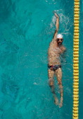 Michael Phelps swims the backstroke in the warm up pool during the 2014 Arena Grand Prix of Santa Clara at the George F Haines International Swim...