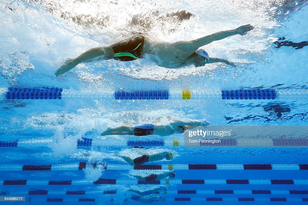Michael Phelps Tim Phillips and Seth Stubblefield of the United States compete in a heat for the Men's 100 Meter Butterfly during Day Six of the 2016...