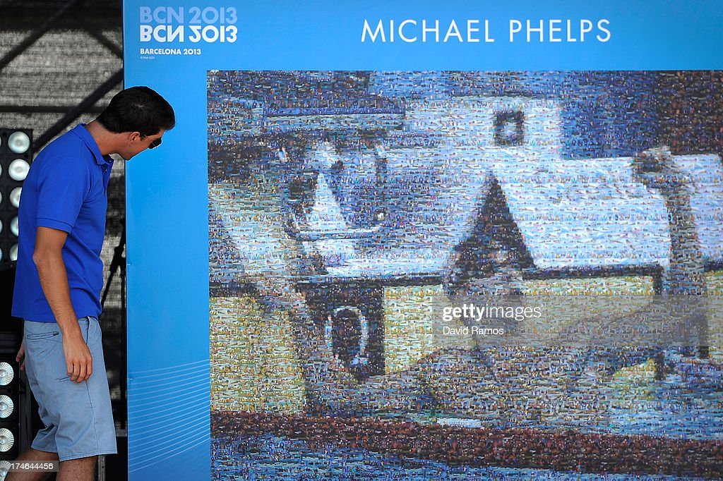 Michael Phelps unveils a mosaic featuring one of his victories on the last Barcelona 2003 Swimming Championships during the Barcelona 2013 World Swimming Championships on July 28, 2013 in Barcelona, Spain.