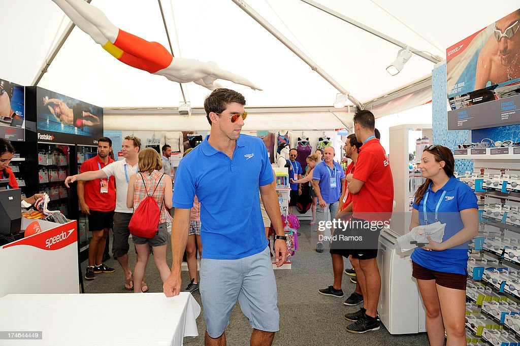 Michael Phelps visits the Speedo Store during the Barcelona 2013 World Swimming Championships on July 28, 2013 in Barcelona, Spain.