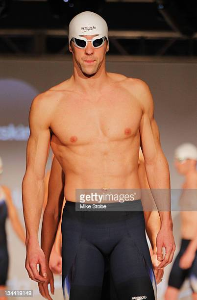 Michael Phelps walks on a stage during a press conference to debut the new Speedo FASTSKIN 3 at Skylight Studios on November 30 2011 in New York City
