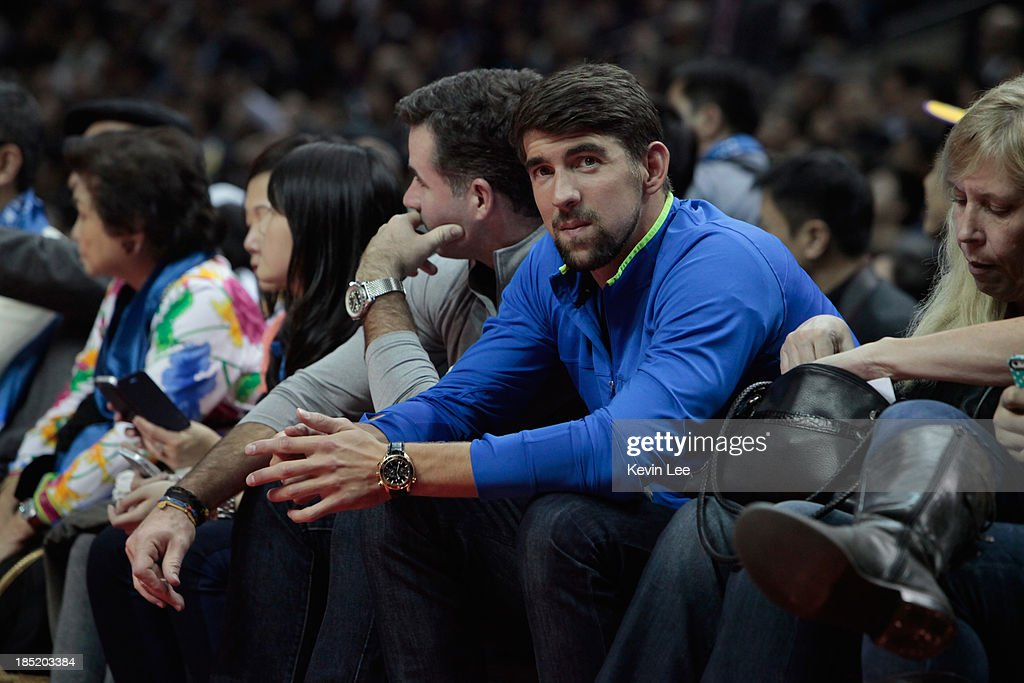 <a gi-track='captionPersonalityLinkClicked' href=/galleries/search?phrase=Michael+Phelps&family=editorial&specificpeople=162698 ng-click='$event.stopPropagation()'>Michael Phelps</a> watches the NBA match between the Los Angeles Lakers and the Golden State Warriors on October 18, 2013 in Shanghai, China.