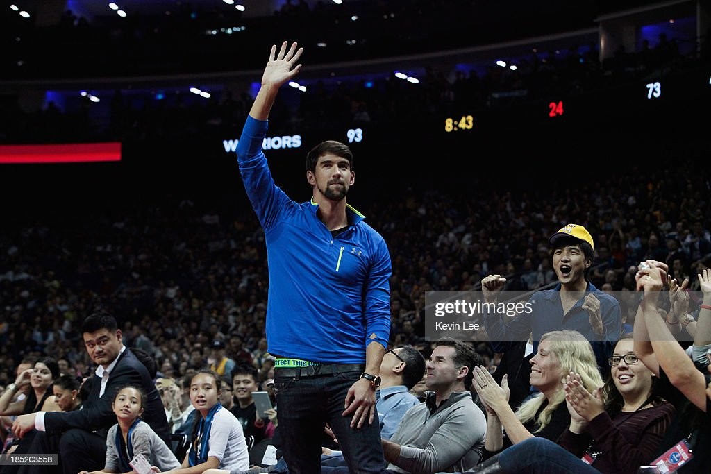 <a gi-track='captionPersonalityLinkClicked' href=/galleries/search?phrase=Michael+Phelps&family=editorial&specificpeople=162698 ng-click='$event.stopPropagation()'>Michael Phelps</a> wavesduring the NBA match between the Los Angeles Lakers and the Golden State Warriors on October 18, 2013 in Shanghai, China.