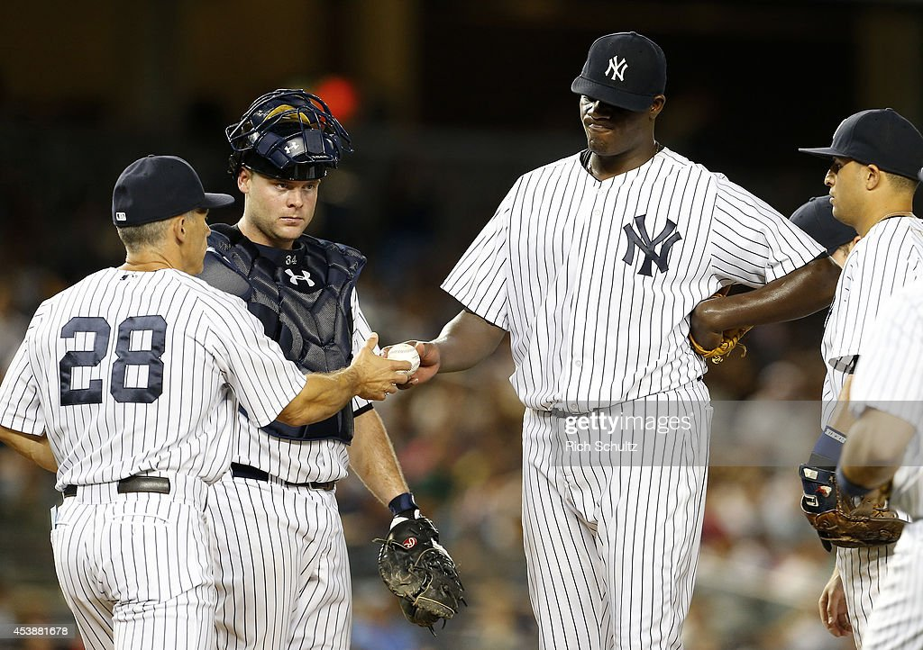 <a gi-track='captionPersonalityLinkClicked' href=/galleries/search?phrase=Michael+Pineda&family=editorial&specificpeople=7509057 ng-click='$event.stopPropagation()'>Michael Pineda</a> #35 of the New York Yankees hands the ball to manager <a gi-track='captionPersonalityLinkClicked' href=/galleries/search?phrase=Joe+Girardi&family=editorial&specificpeople=208659 ng-click='$event.stopPropagation()'>Joe Girardi</a> #28 as he is taken out of the game in the seventh inning against the Houston Astros as catcher <a gi-track='captionPersonalityLinkClicked' href=/galleries/search?phrase=Brian+McCann+-+Baseball+Player&family=editorial&specificpeople=593065 ng-click='$event.stopPropagation()'>Brian McCann</a> #34 looks on during a MLB baseball game at Yankee Stadium on August 20, 2014 in the Bronx borough of New York City.