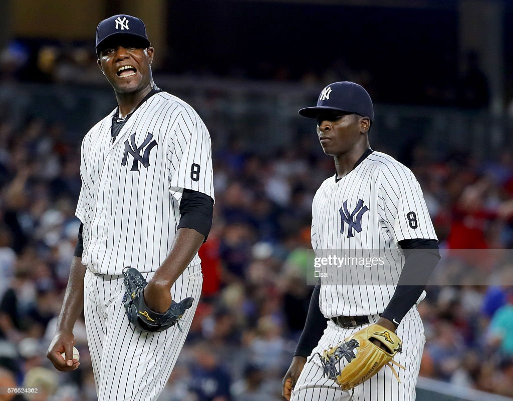 Michael Pineda #35 of the New York Yankees reacts as he is pulled from the game in the sixth inning against the Boston Red Sox at Yankee Stadium on July 15, 2016 in the Bronx borough of New York City.Teammate Didi Gregorius #18 of the New York Yankees stands by for support.