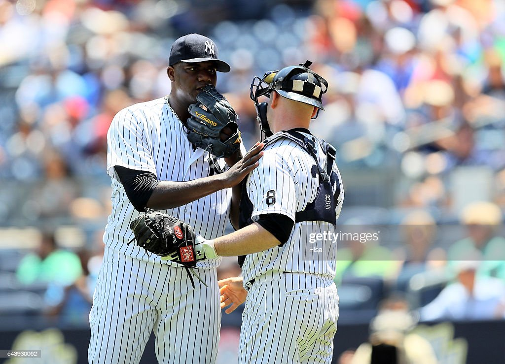 <a gi-track='captionPersonalityLinkClicked' href=/galleries/search?phrase=Michael+Pineda&family=editorial&specificpeople=7509057 ng-click='$event.stopPropagation()'>Michael Pineda</a> #35 of the New York Yankees talks with <a gi-track='captionPersonalityLinkClicked' href=/galleries/search?phrase=Brian+McCann+-+Baseball+Player&family=editorial&specificpeople=593065 ng-click='$event.stopPropagation()'>Brian McCann</a> #34 in the first inning against the Texas Rangers at Yankee Stadium on June 30, 2016 in the Bronx borough of New York City.