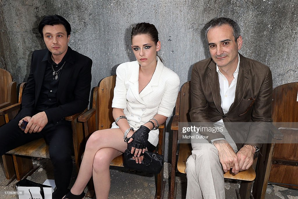 Michael Pitt, Kristen Stewart and Olivier Assayas attend the Chanel show as part of Paris Fashion Week Haute-Couture Fall/Winter 2013-2014 at Grand Palais on July 2, 2013 in Paris, France.