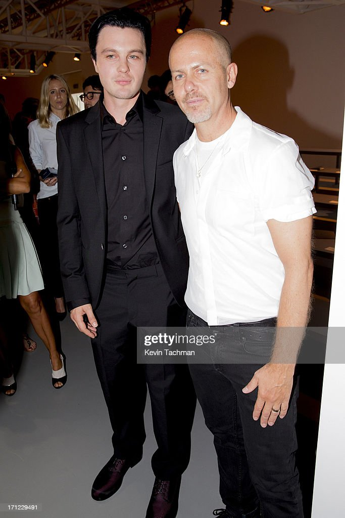 Michael Pitt, left, and designer Italo Zucchelli attend the Calvin Klein Collection show during Milan Menswear Fashion Week Spring Summer 2014 on June 23, 2013 in Milan, Italy.