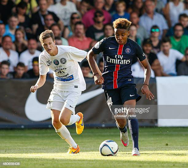 Michael Pittnauer of Wiener Sportklub competes for the ball with Christopher Nkunku of Paris SaintGermain the Friendly Match between Wiener Sportklub...