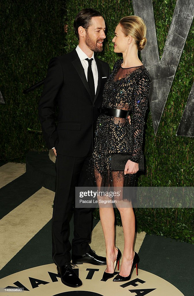 Michael Polish and actress <a gi-track='captionPersonalityLinkClicked' href=/galleries/search?phrase=Kate+Bosworth&family=editorial&specificpeople=201616 ng-click='$event.stopPropagation()'>Kate Bosworth</a> arrive at the 2012 Vanity Fair Oscar Party hosted by Graydon Carter at Sunset Tower on February 26, 2012 in West Hollywood, California.