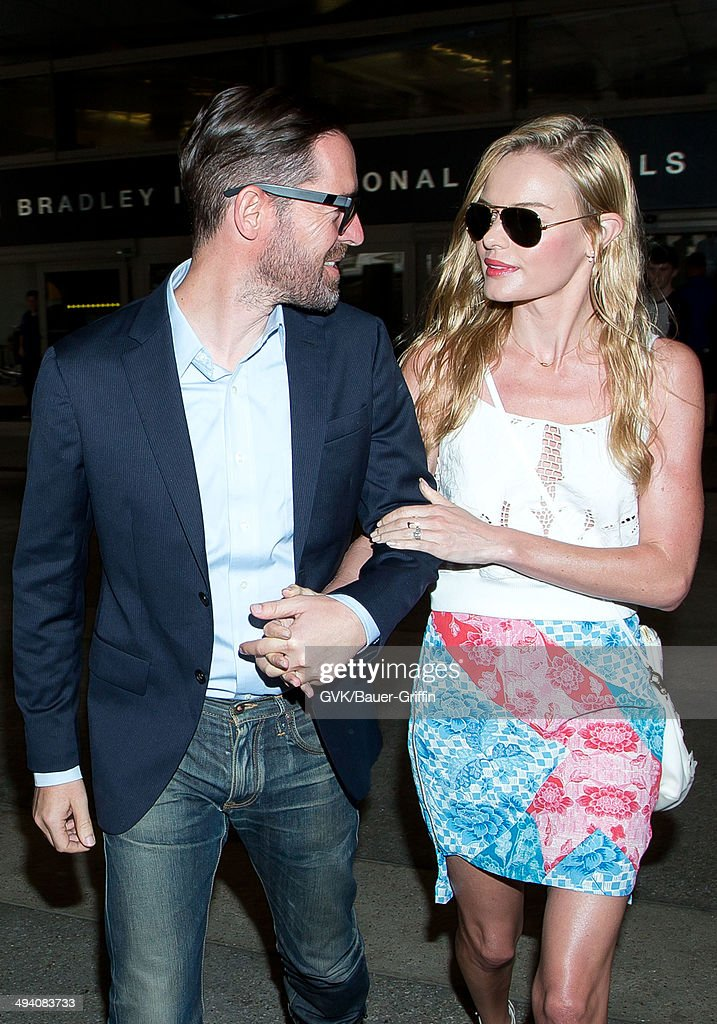 <a gi-track='captionPersonalityLinkClicked' href=/galleries/search?phrase=Michael+Polish&family=editorial&specificpeople=3204536 ng-click='$event.stopPropagation()'>Michael Polish</a> and <a gi-track='captionPersonalityLinkClicked' href=/galleries/search?phrase=Kate+Bosworth&family=editorial&specificpeople=201616 ng-click='$event.stopPropagation()'>Kate Bosworth</a> are seen at LAX on May 27, 2014 in Los Angeles, California.