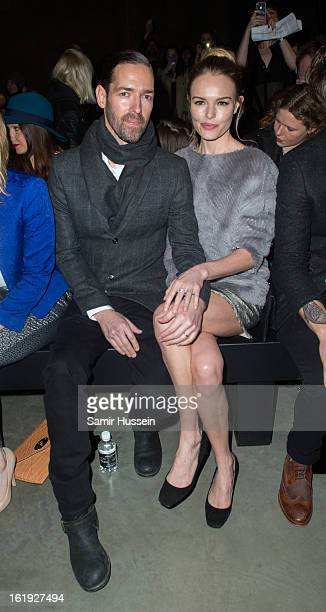 Michael Polish and Kate Bosworth attend the Topshop Unique show at the Tate Modern during London Fashion Week Fall/Winter 2013/14 on February 17 2013...