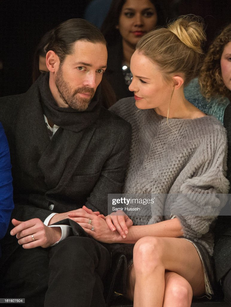 Michael Polish and Kate Bosworth attend the Topshop Unique show at the Tate Modern during London Fashion Week Fall/Winter 2013/14 on February 17, 2013 in London, England.