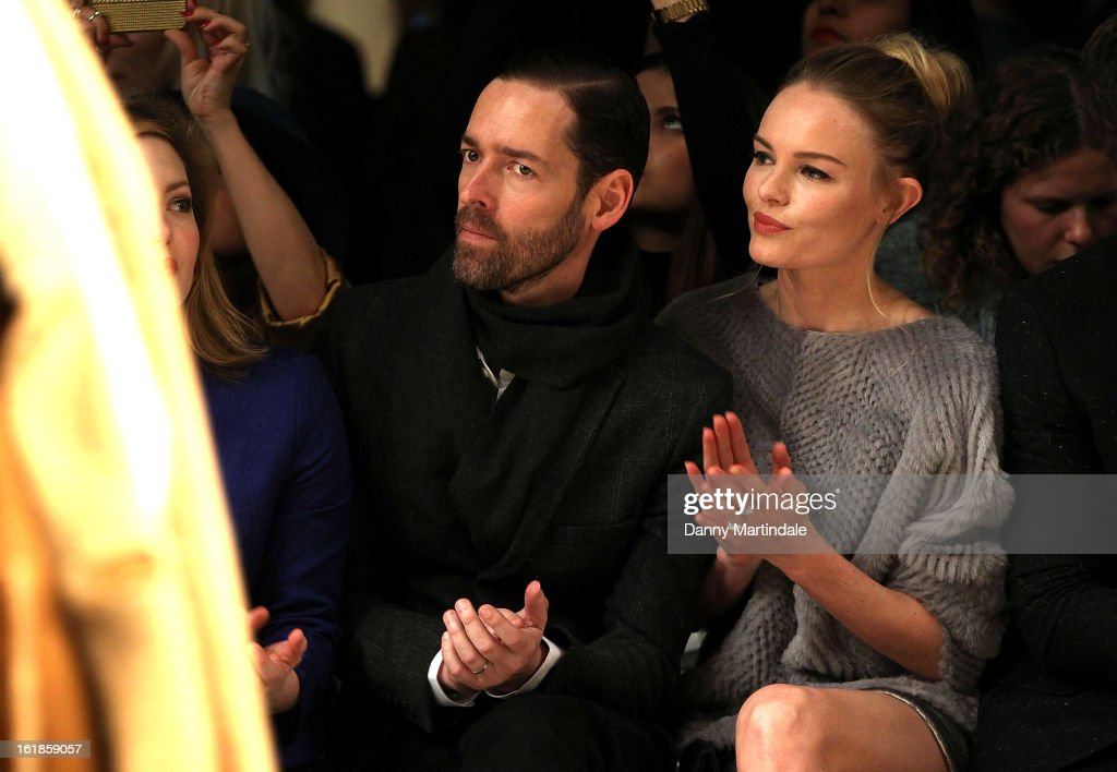 Michael Polish and Kate Bosworth attend the Unique show during London Fashion Week Fall/Winter 2013/14 at TopShop Show Space on February 17, 2013 in London, England.