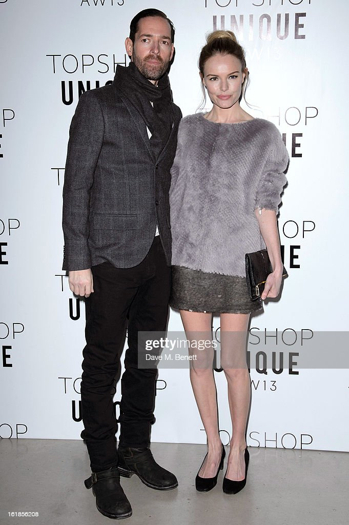 Michael Polish and Kate Bosworth attends the Topshop Unique Autumn/ Winter 2013 catwalk show at the Topshop Show Space on February 17, 2013 in London, England.