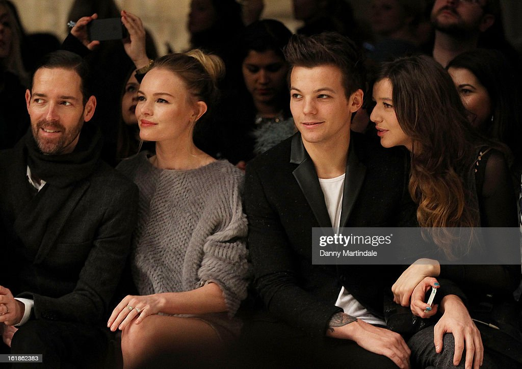 Michael Polish, Kate Bosworth, Louis Tomlinson from One Direction and girlfriend Eleanor Calder attends the Unique show during London Fashion Week Fall/Winter 2013/14 at TopShop Show Space on February 17, 2013 in London, England.
