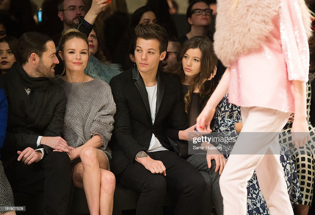 Michael Polish, Kate Bosworth, Louis Tomlinson from One Direction and Eleanor Calder attend the Topshop Unique show at the Tate Modern during London Fashion Week Fall/Winter 2013/14 on February 17, 2013 in London, England.