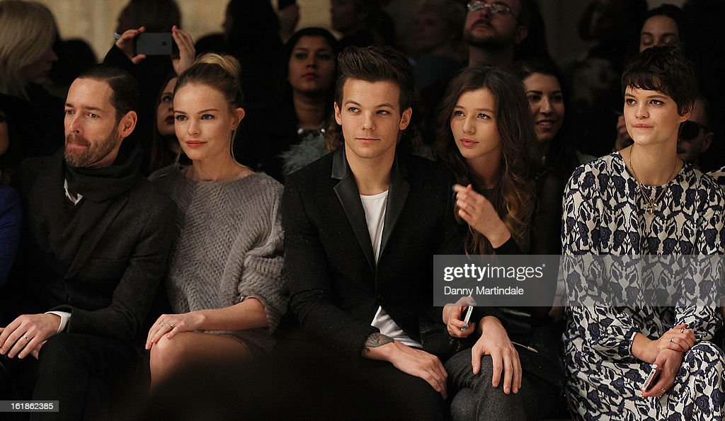 Michael Polish, Kate Bosworth, Louis Tomlinson from One Direction, girlfriend Eleanor Calder and Pixie Geldof attends the Unique show during London Fashion Week Fall/Winter 2013/14 at TopShop Show Space on February 17, 2013 in London, England.