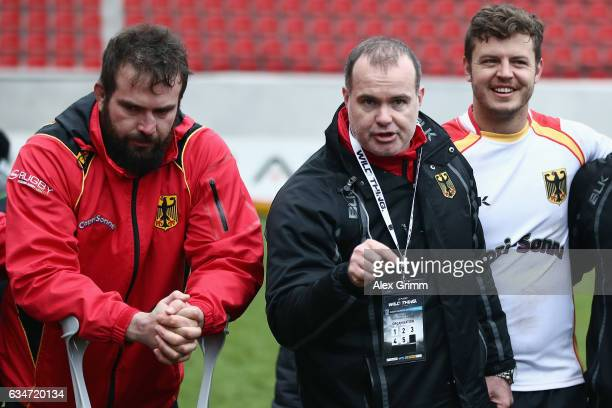 Michael Poppmeier head coach Kobus Potgieter and Raynor Parkinson of Germany react after the European Shield Rugby match between Germany and Romania...
