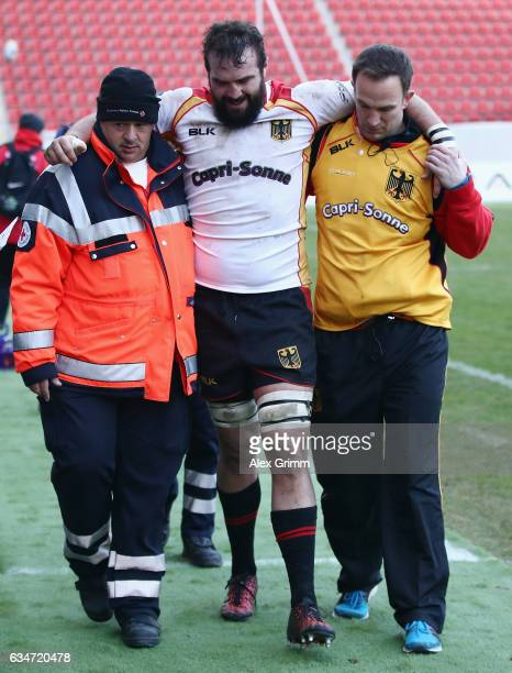 Michael Poppmeier of Germany is led off the pitch during the European Shield Rugby match between Germany and Romania at SpardaBankHessenStadion on...