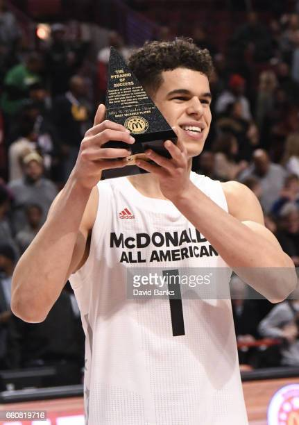 Michael Porter Jr #1 of the boys west team holds the MVP trophy at the 2017 McDonalds's All American Game on March 29 2017 at the United Center in...