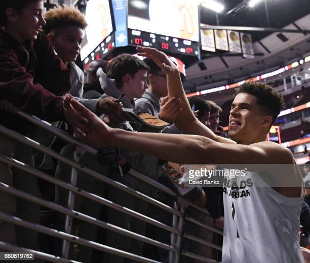 Michael Porter Jr #1 of the boys west team shakes hands with the fans after the 2017 McDonalds's All American Game on March 29 2017 at the United...