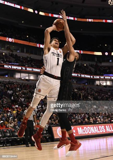 Michael Porter Jr #1of the boys west team is defended by Kevin Knox II of the boys east team during the 2017 McDonalds's All American Game on March...