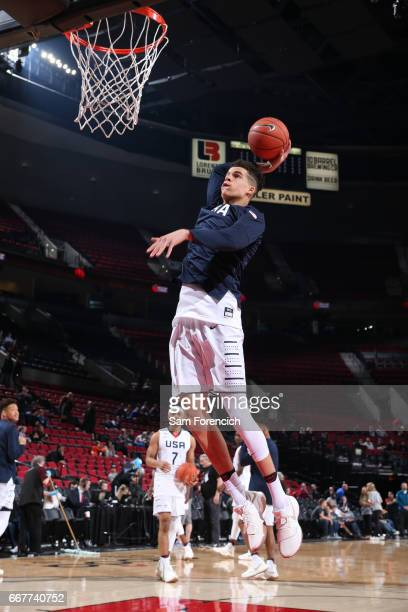Michael Porter Jr #9 of the USA Junior Select Team dunks against the World Select Team during warmups on April 7 2017 at the MODA Center Arena in...