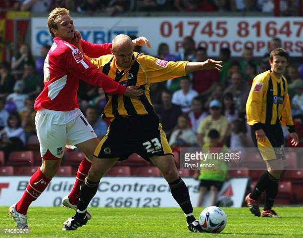 Michael Proctor of Wrexham clashes with Ernie Cooksey of Boston United during CocaCola Football League Two game between Wrexham and Boston United at...