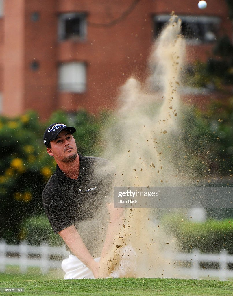 Michael Putnam hits from a bunker on the fist hole during the final round of the Colombia Championship at Country Club de Bogota on March 3, 2013 in Bogota, Colombia.